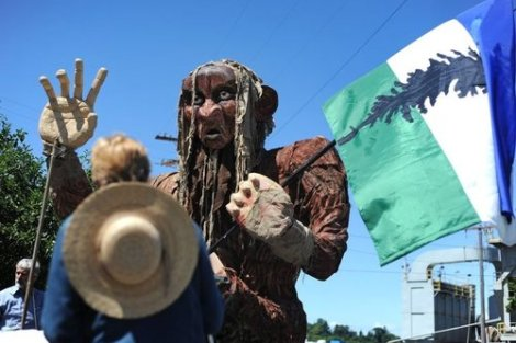A spectator looks at Cascade Now's Sasquatch float before the start of the 2015 Fremont Solstice Parade Saturday, June 20, 2015, in Fremont.